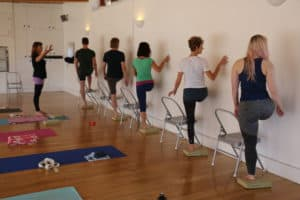 YHLB Yoga Research - Group Standing Chair Twist
